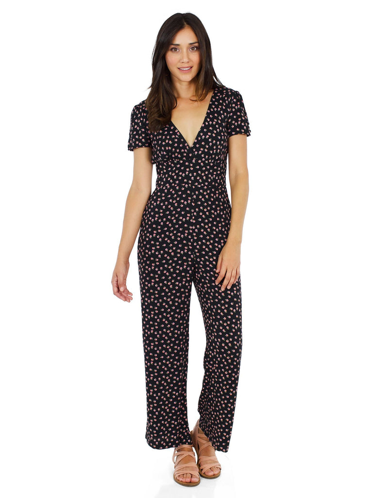 Woman wearing a jumpsuit rental from Free People called Walk This Way Buttondown Top