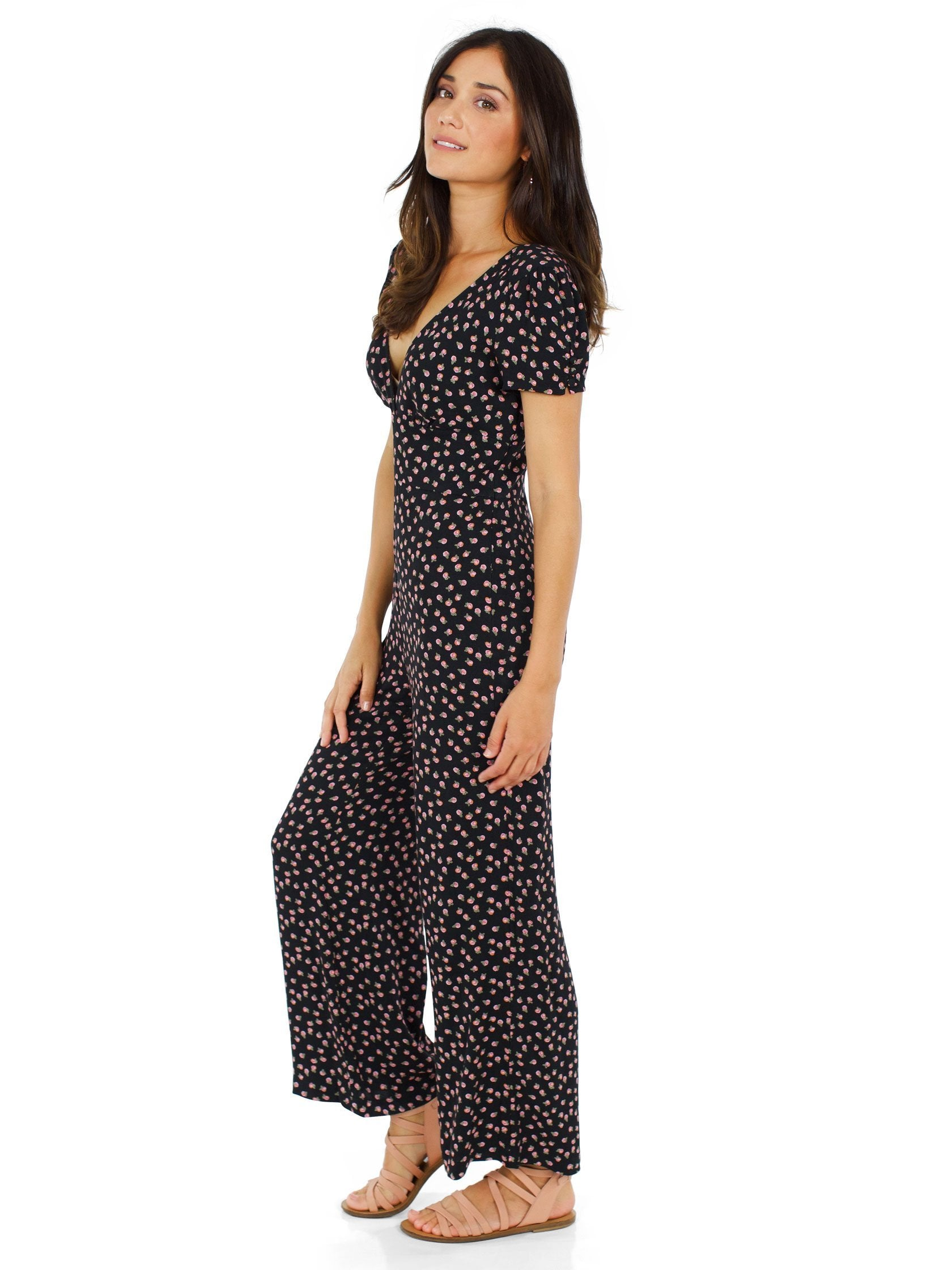 Woman wearing a jumpsuit rental from Free People called Mia Jumpsuit