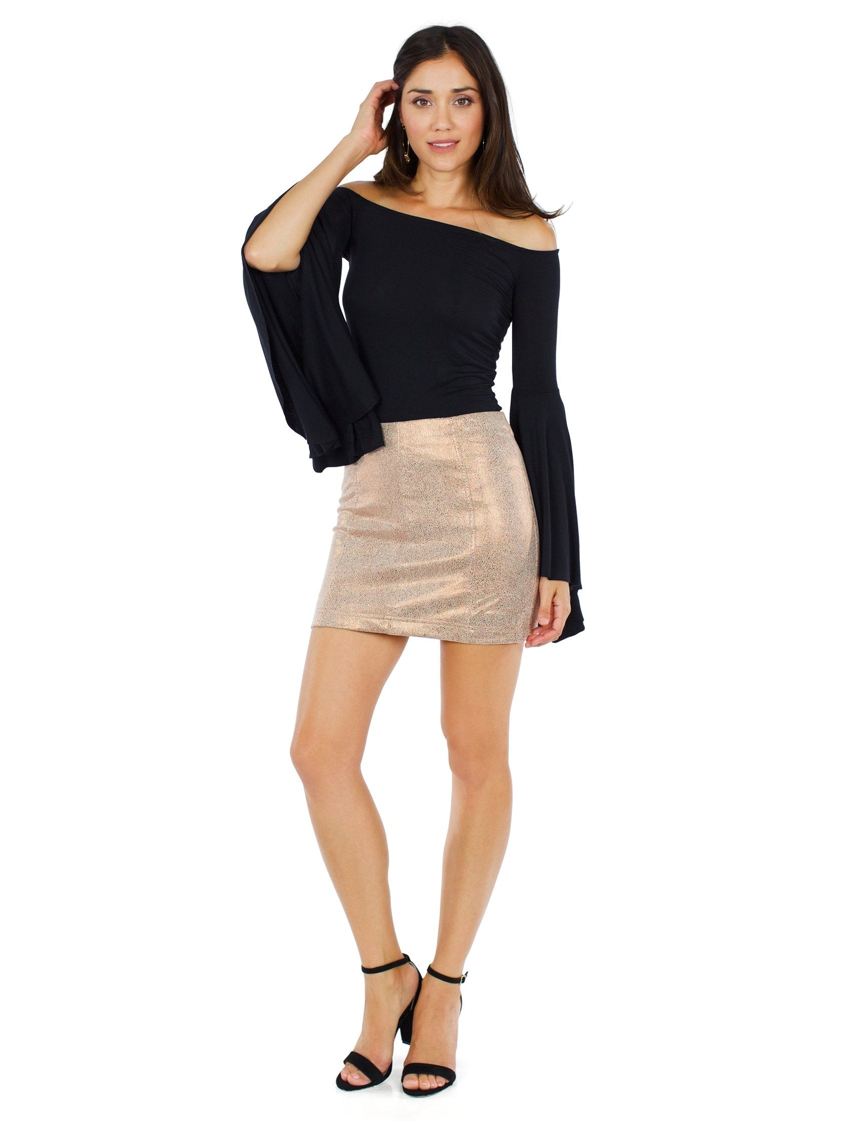 Girl outfit in a skirt rental from Free People called Modern Femme Metallic Rose Gold Suede Mini Skirt