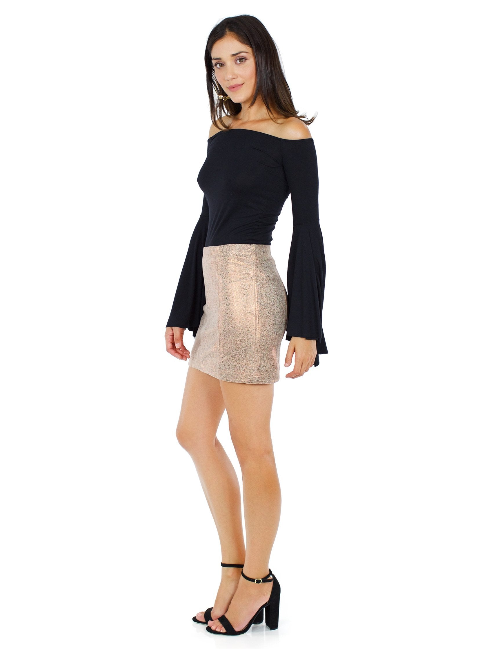 Woman wearing a skirt rental from Free People called Modern Femme Metallic Rose Gold Suede Mini Skirt