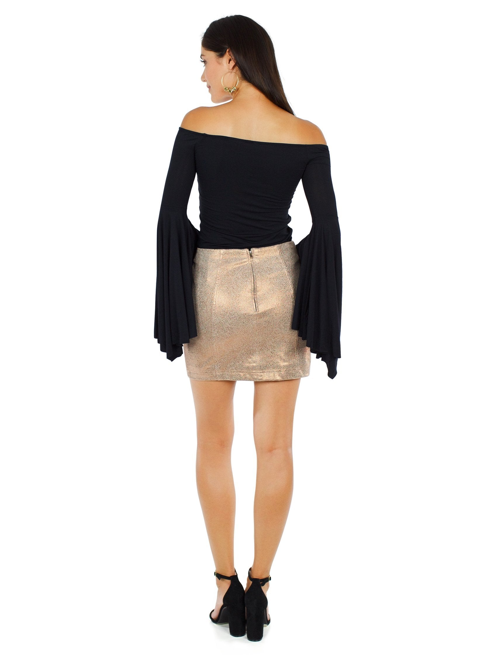Women wearing a skirt rental from Free People called Modern Femme Metallic Rose Gold Suede Mini Skirt