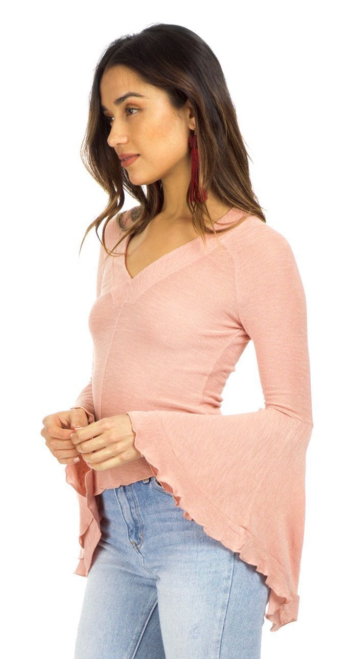 Women wearing a top rental from Free People called Soo Dramatic Long Sleeve Top