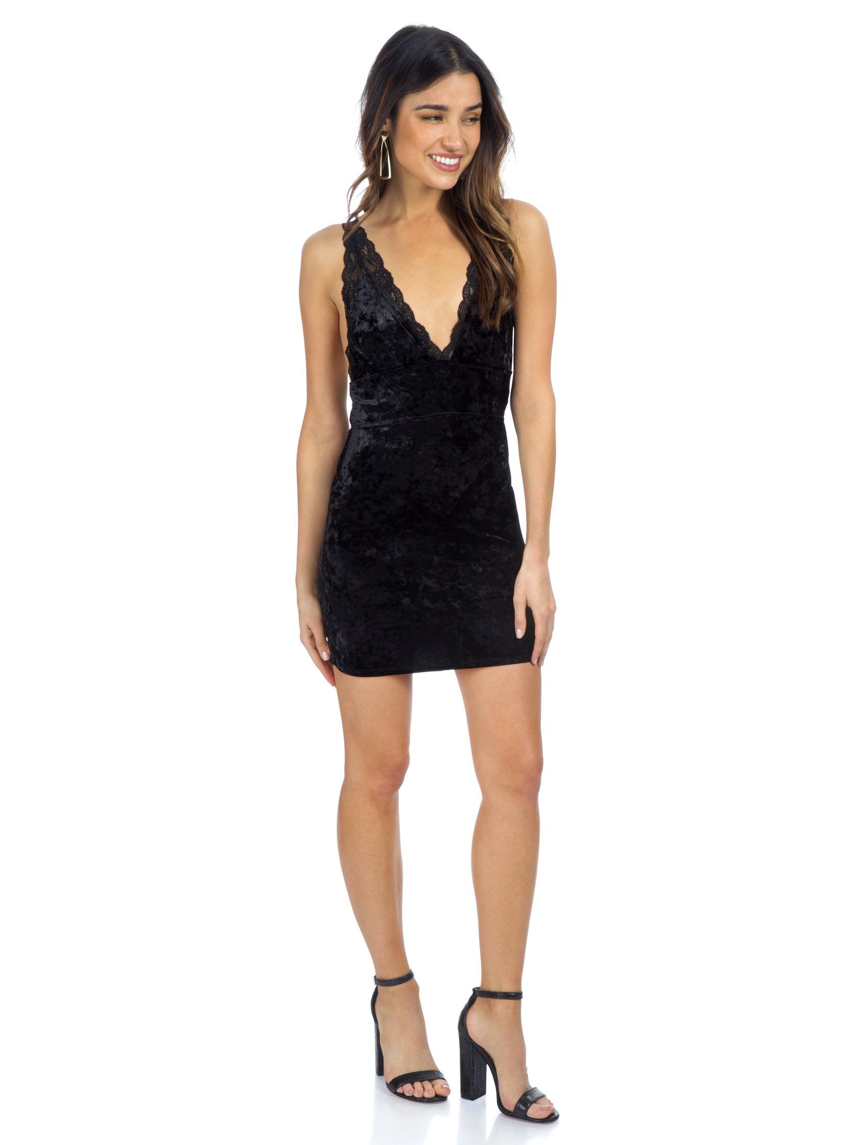 Woman wearing a dress rental from Free People called Viper Velvet Bodycon
