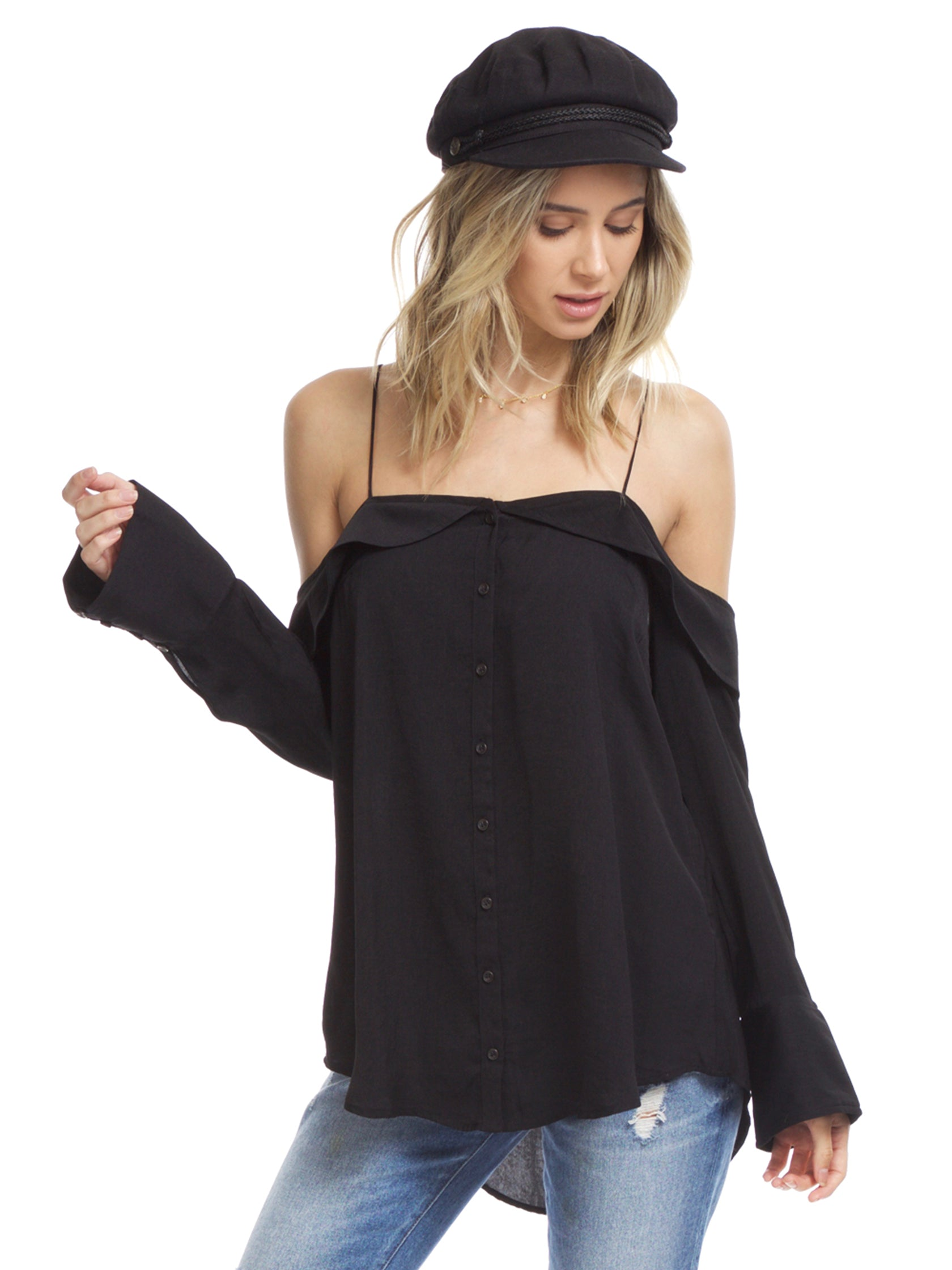 Woman wearing a top rental from Free People called Walk This Way Buttondown Top