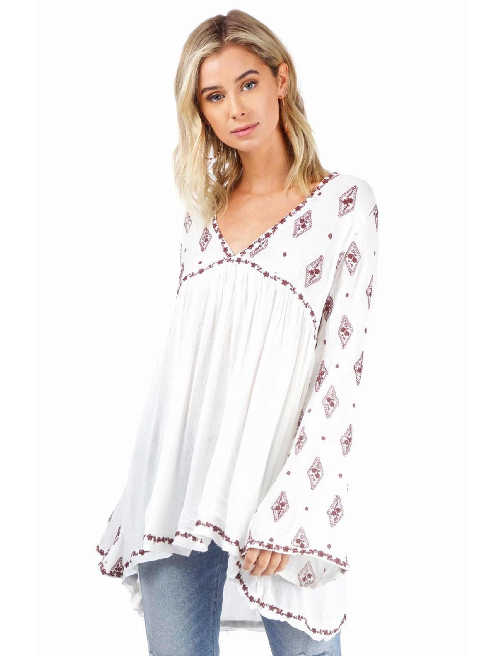 Woman wearing a top rental from Free People called Diamond Embroidered Top