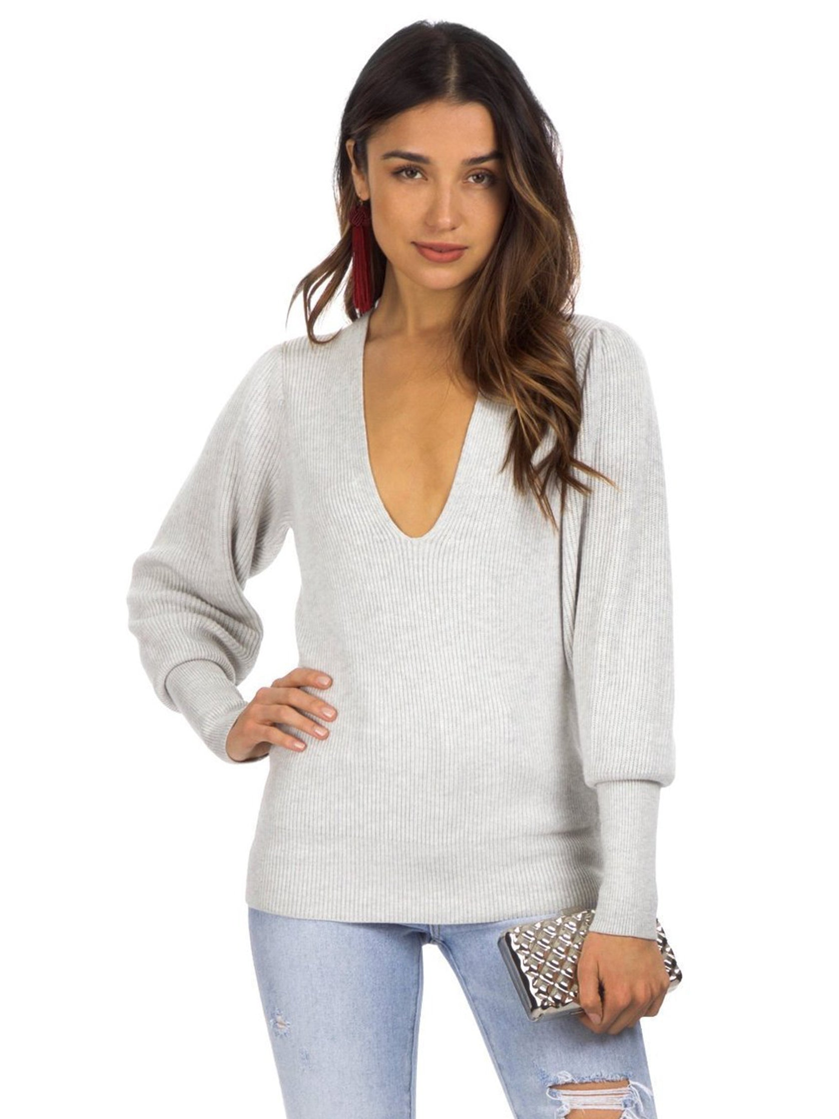 Woman wearing a sweater rental from Free People called Gingersnap Tunic