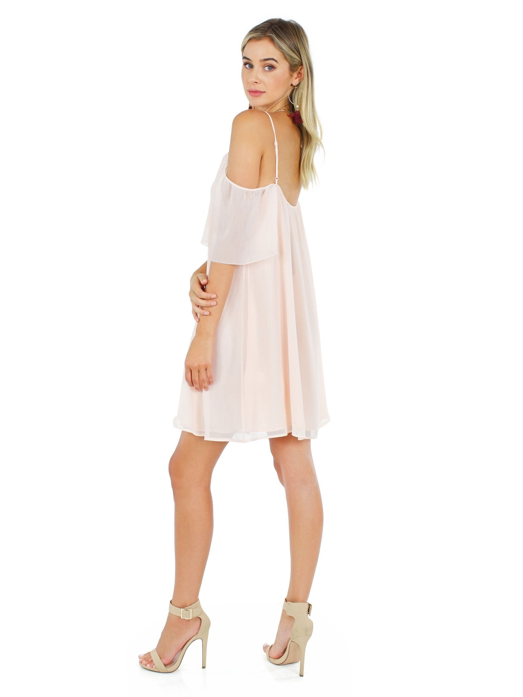 Woman wearing a dress rental from French Connection called Constance Drape Cold Shoulder Dress