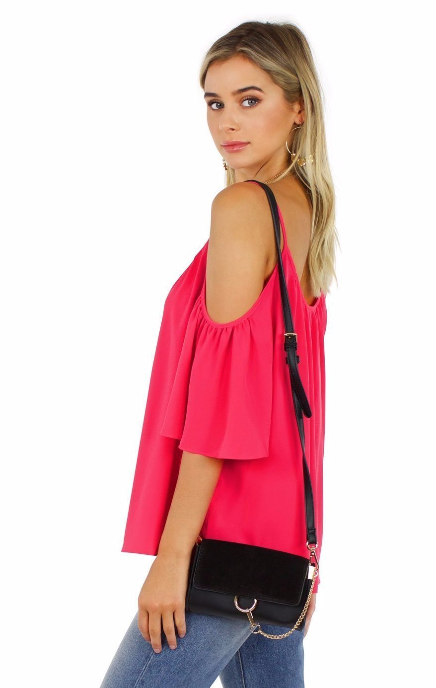 Woman wearing a top rental from French Connection called Crepe Light Cut Out Shoulder Top