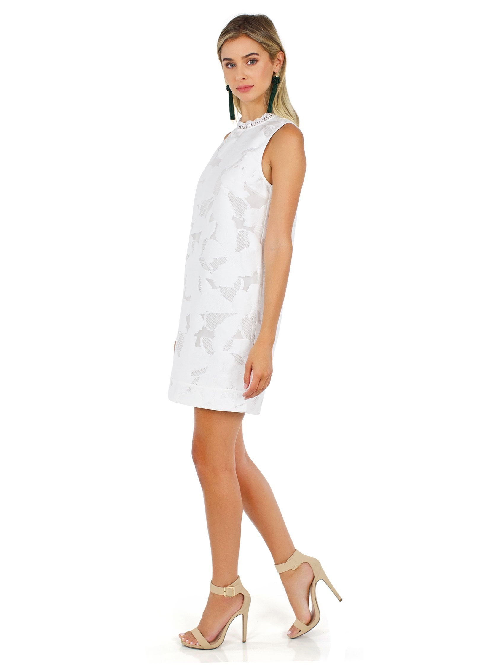 Woman wearing a dress rental from French Connection called Deka Lace Shift Dress