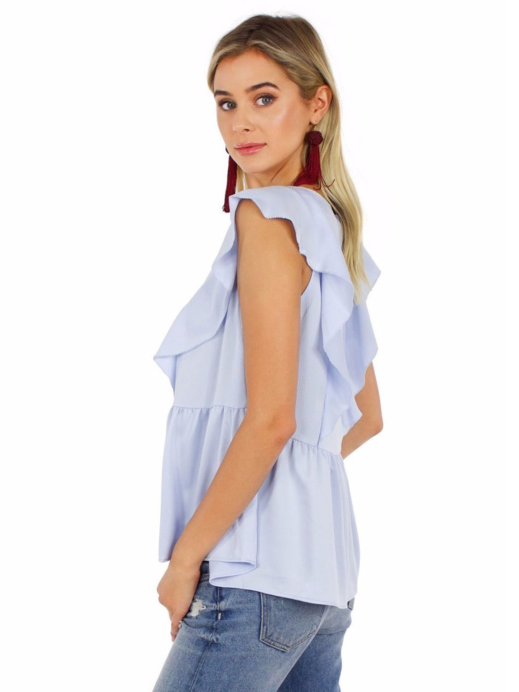 Woman wearing a top rental from French Connection called Nia Drape