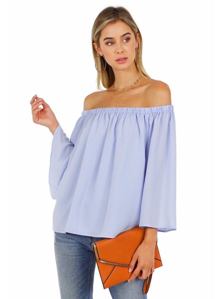 Girl wearing a top rental from French Connection called Neema Peplum Top