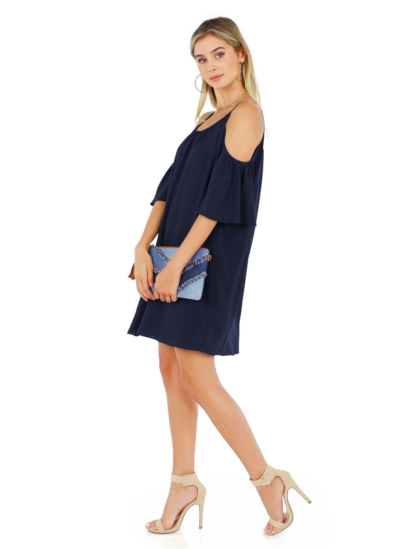 Woman wearing a dress rental from French Connection called Polly Plains Cold Shoulder Dress