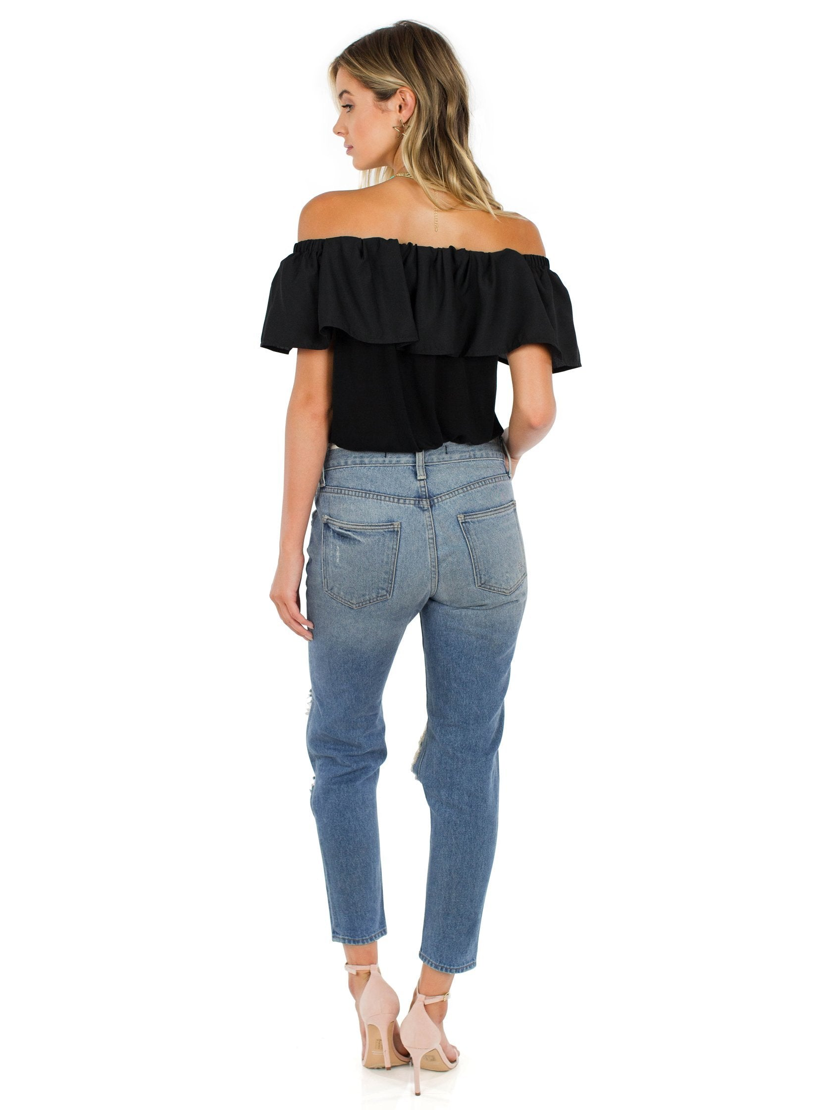 Girl wearing a top rental from French Connection called Polly Plains Off-the-shoulder Top