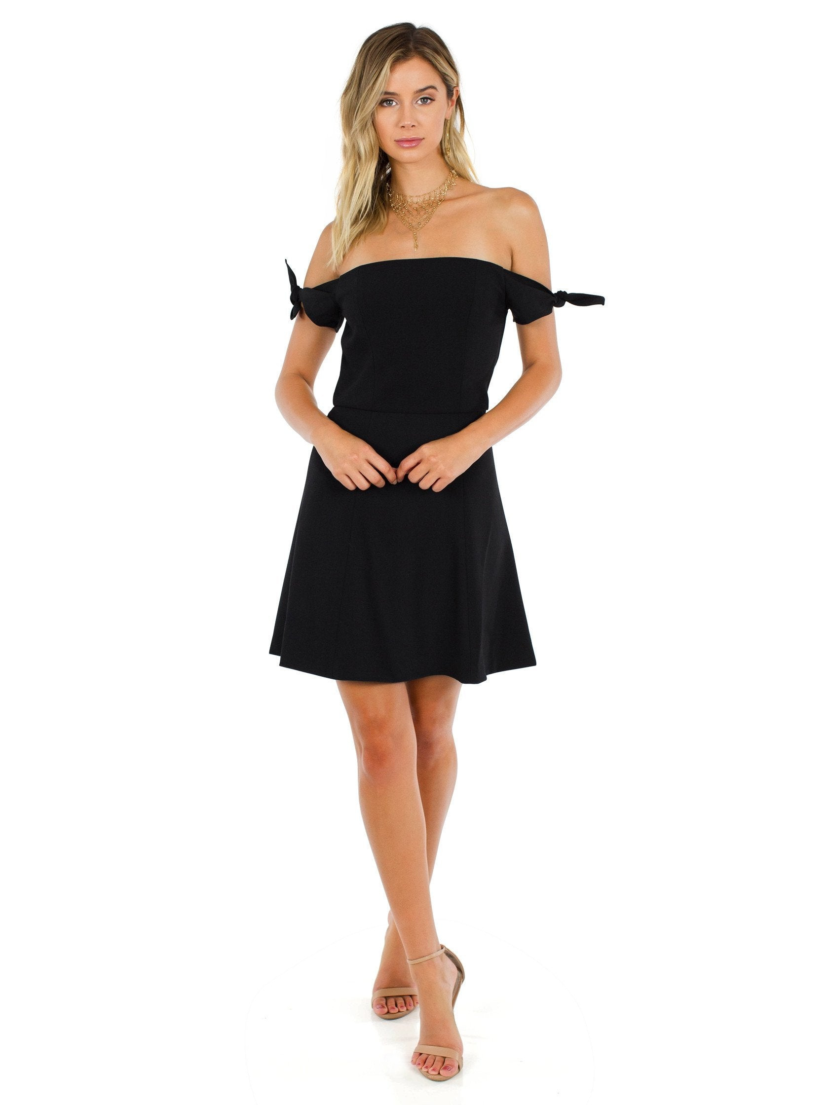 Girl outfit in a dress rental from French Connection called Whisper Light Off The Shoulder Dress