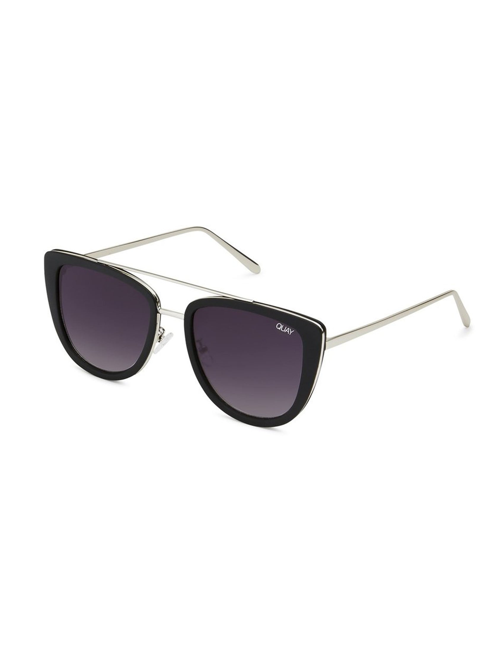 af9b9158c6 Woman wearing a sunglasses rental from Quay Australia called French Kiss  55mm Cat Eye Sunglasses