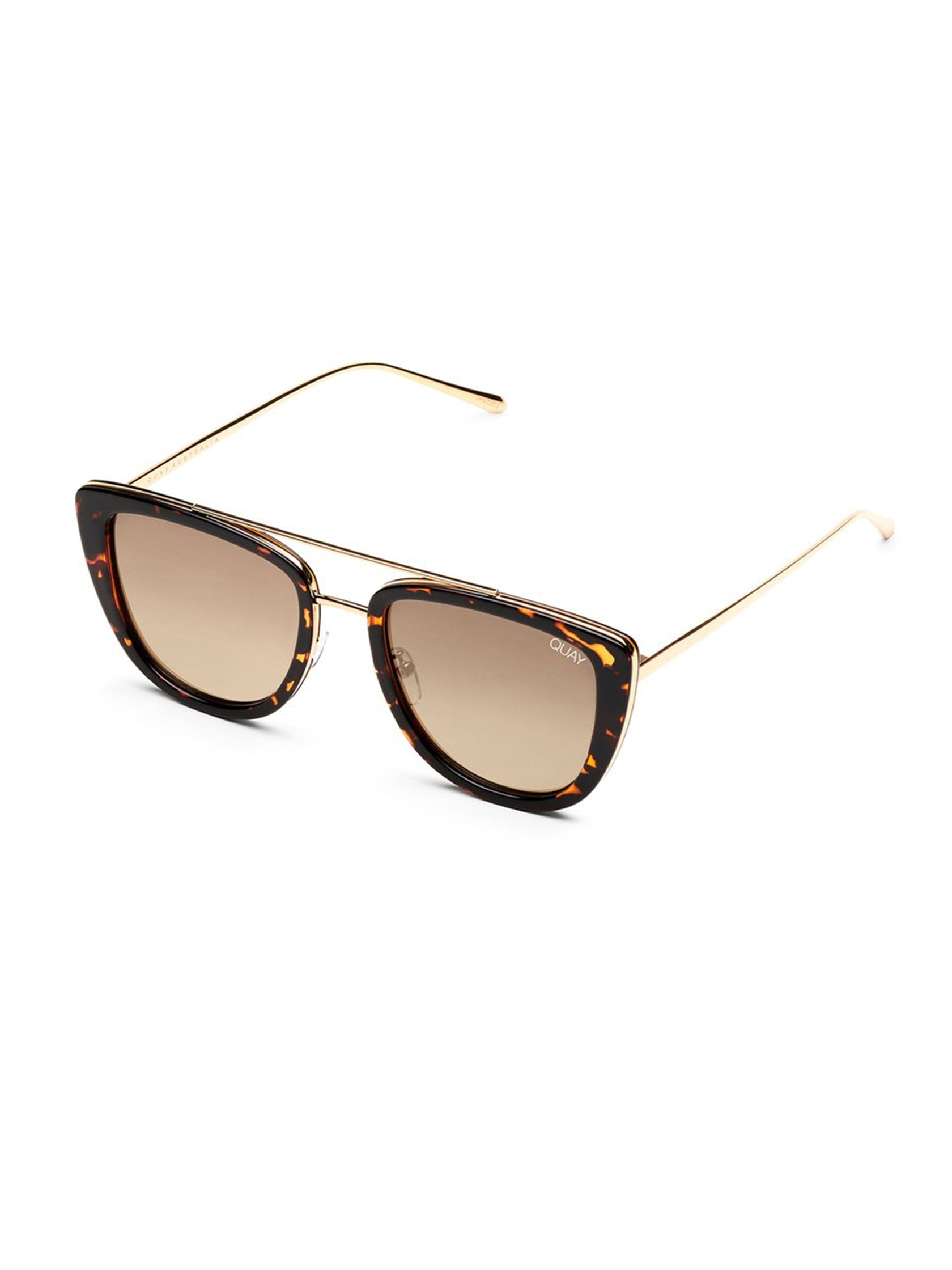 Woman wearing a sunglasses rental from Quay Australia called French Kiss Sunglasses