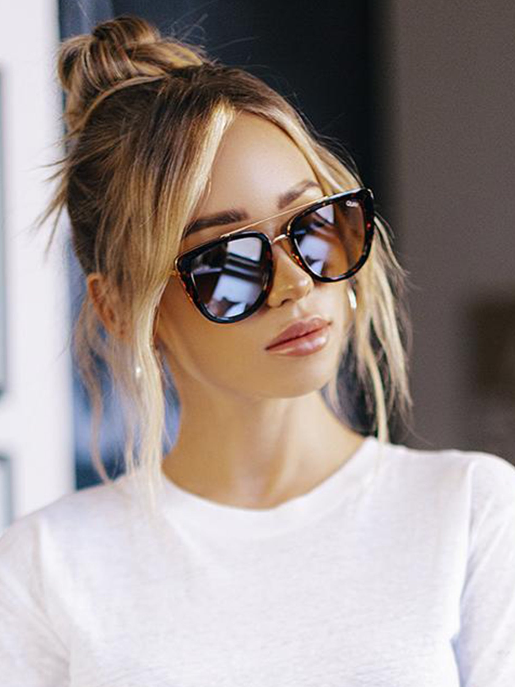 Women wearing a sunglasses rental from Quay Australia called French Kiss Sunglasses