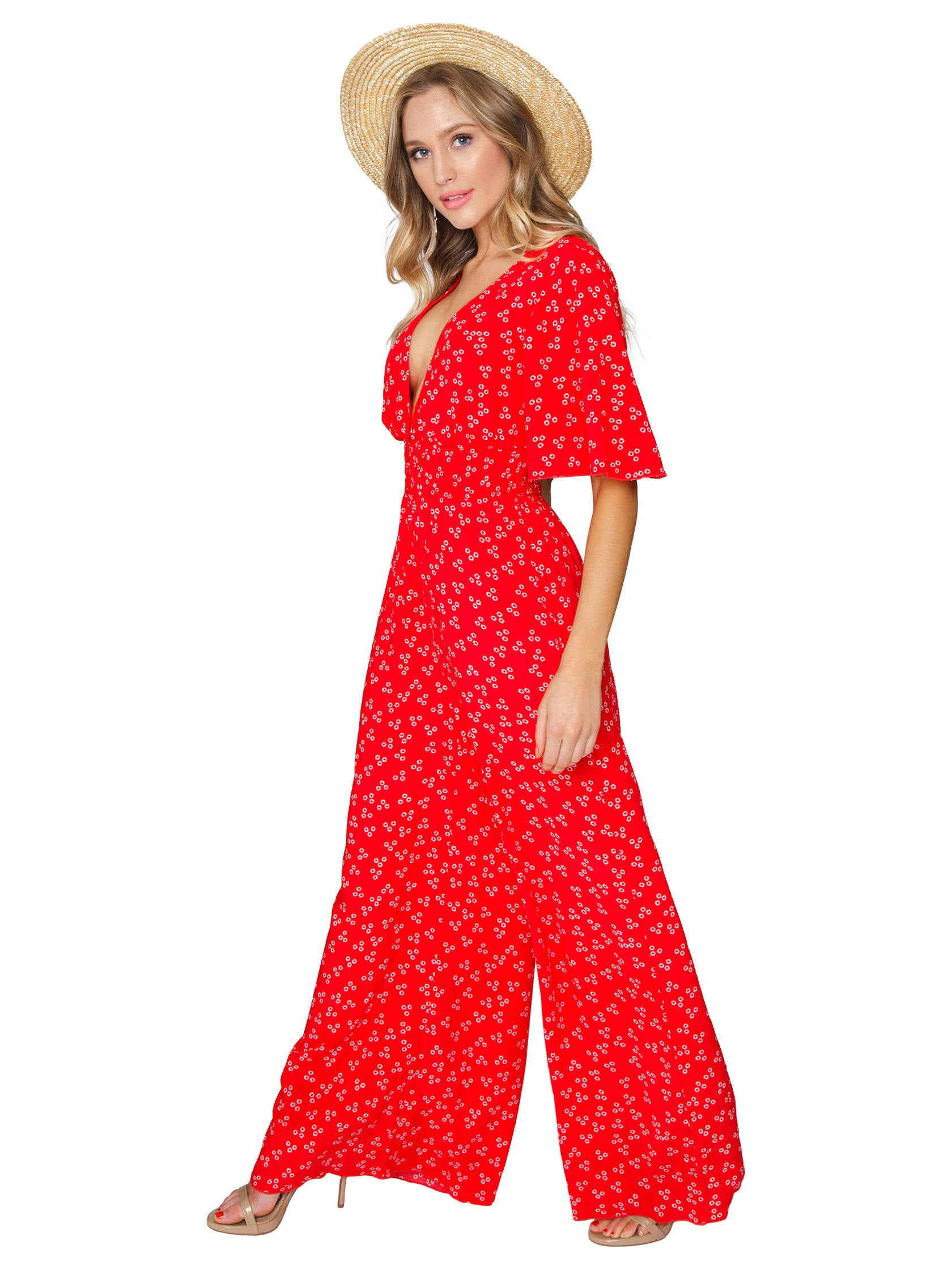 Woman wearing a jumpsuit rental from Finders Keepers called Frida Pantsuit