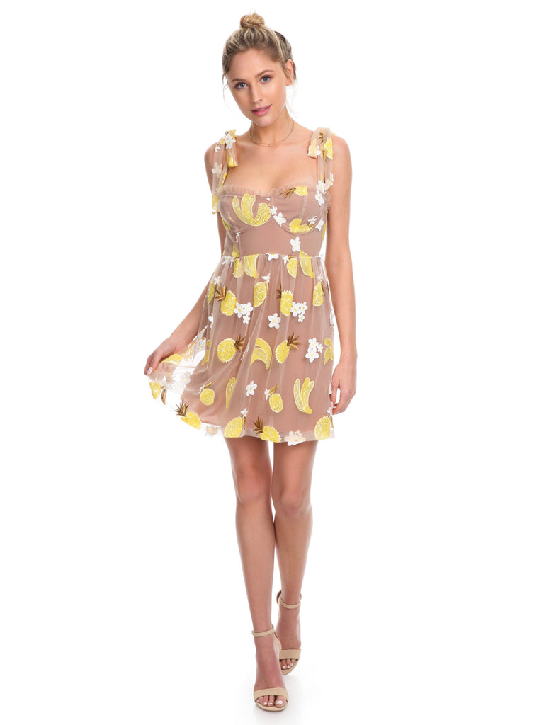 Women wearing a dress rental from For Love & Lemons called Fruitpunch Sequin Mini Dress