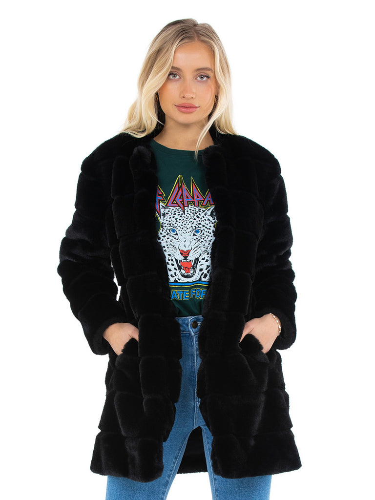 Women wearing a coat rental from BB Dakota called Fur Elise Coat