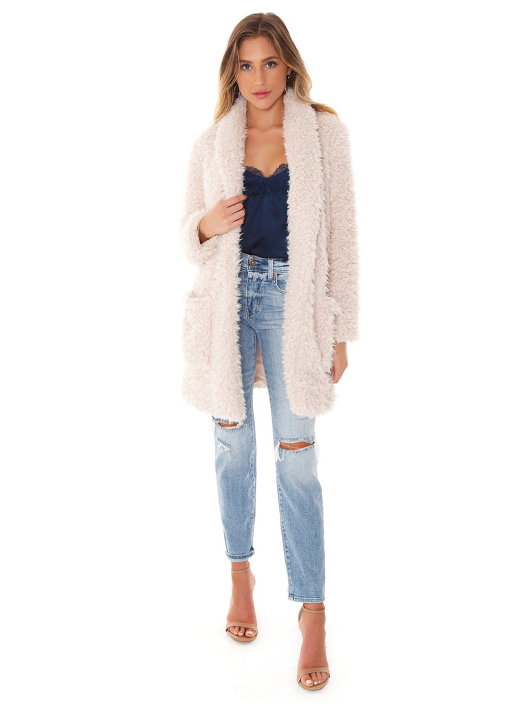 Woman wearing a jacket rental from BB Dakota called Faux Fur Jacket