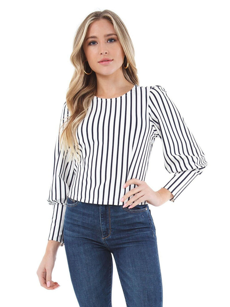 Girl wearing a top rental from Ali & Jay called Debby Stripe Sweater