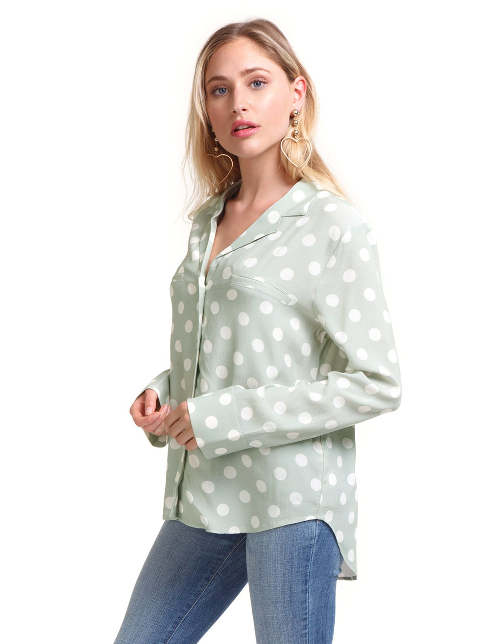 Girl wearing a top rental from Capulet called Geneva Polka Dot Buttondown