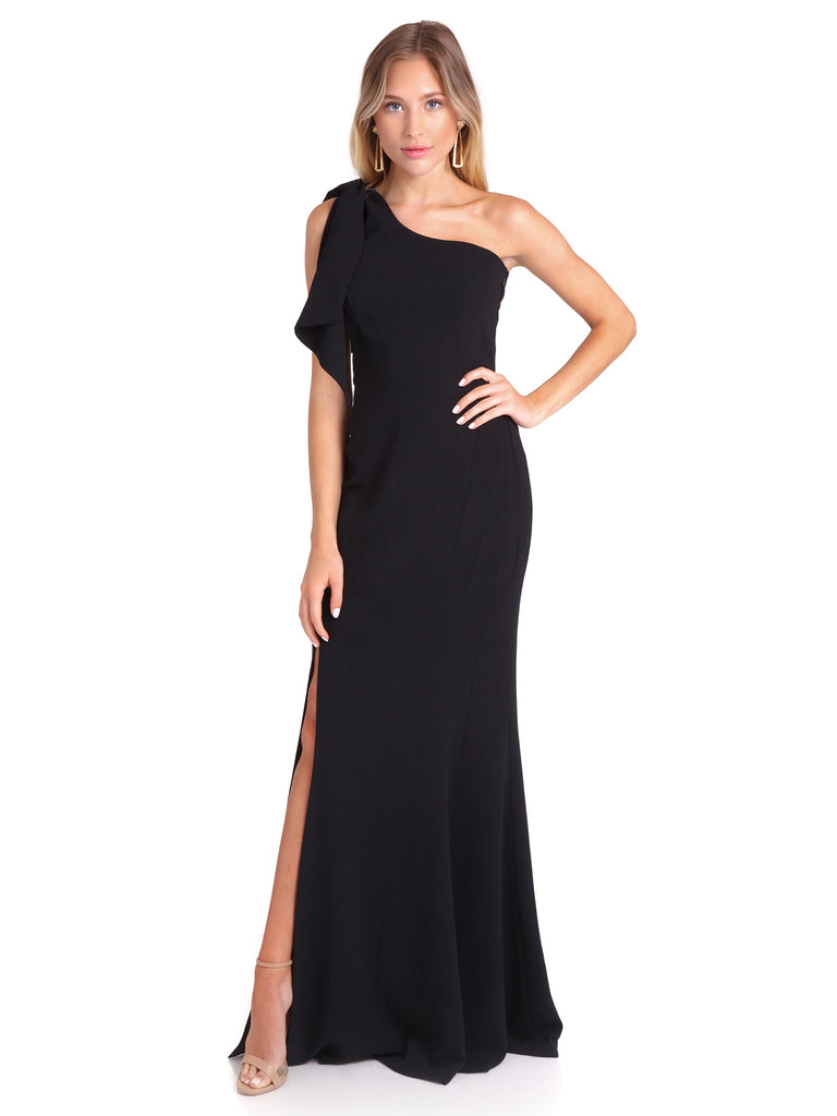 Girl wearing a dress rental from Dress the Population called Georgina Crepe One-shoulder Gown