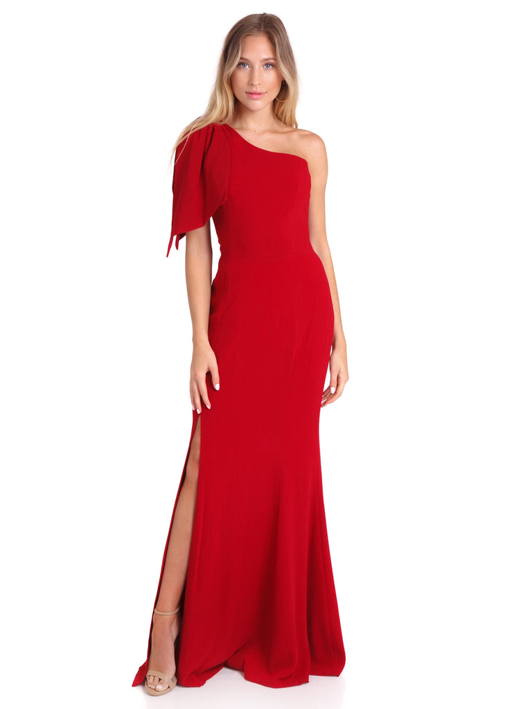 Girl wearing a dress rental from Dress the Population called Meryl Long Sleeve Wrap Maxi Dress
