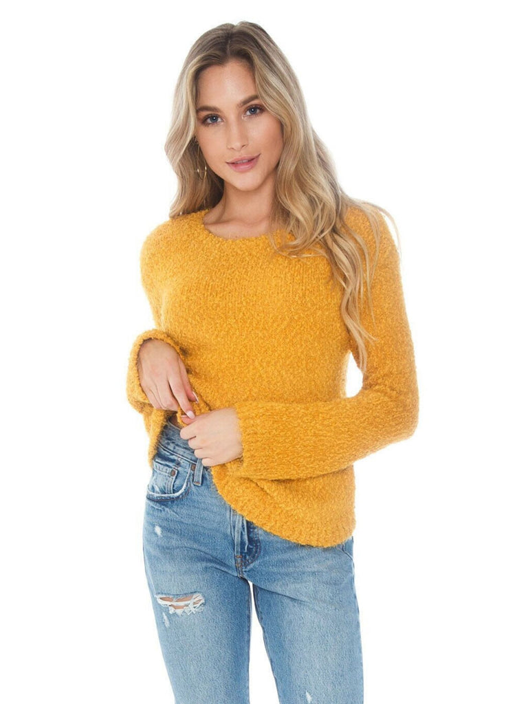 Girl wearing a sweater rental from BB Dakota called Tiger Lily Bell Sleeve Top