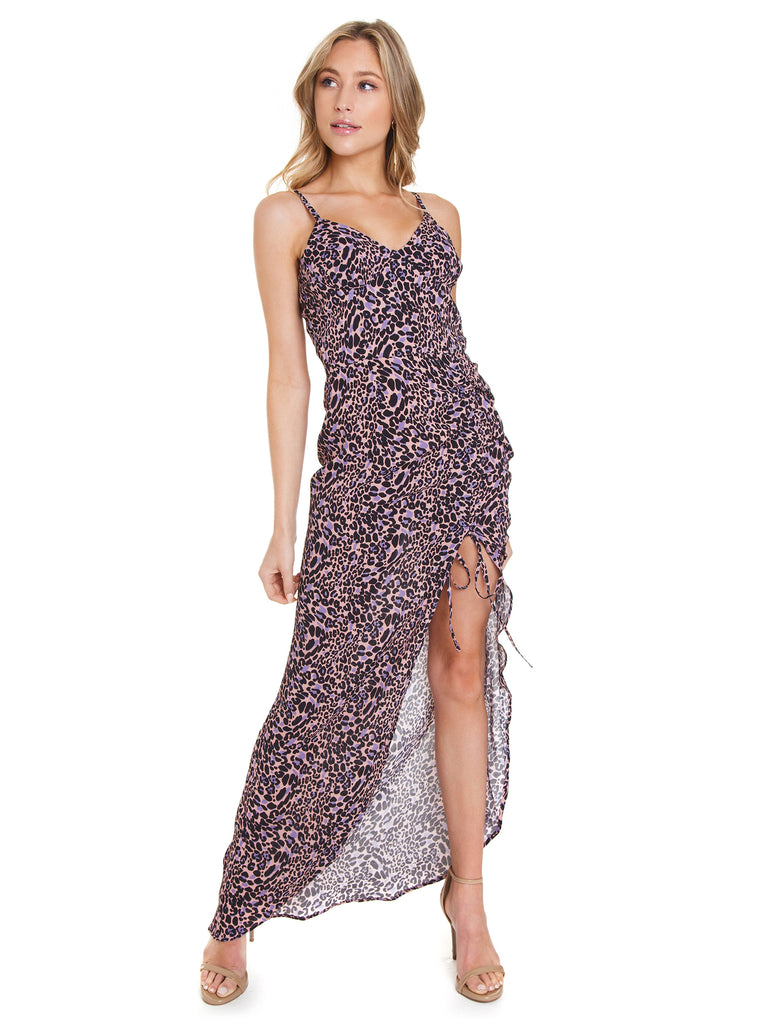 Girl wearing a dress rental from FLETCH called Heat Wave Printed Maxi
