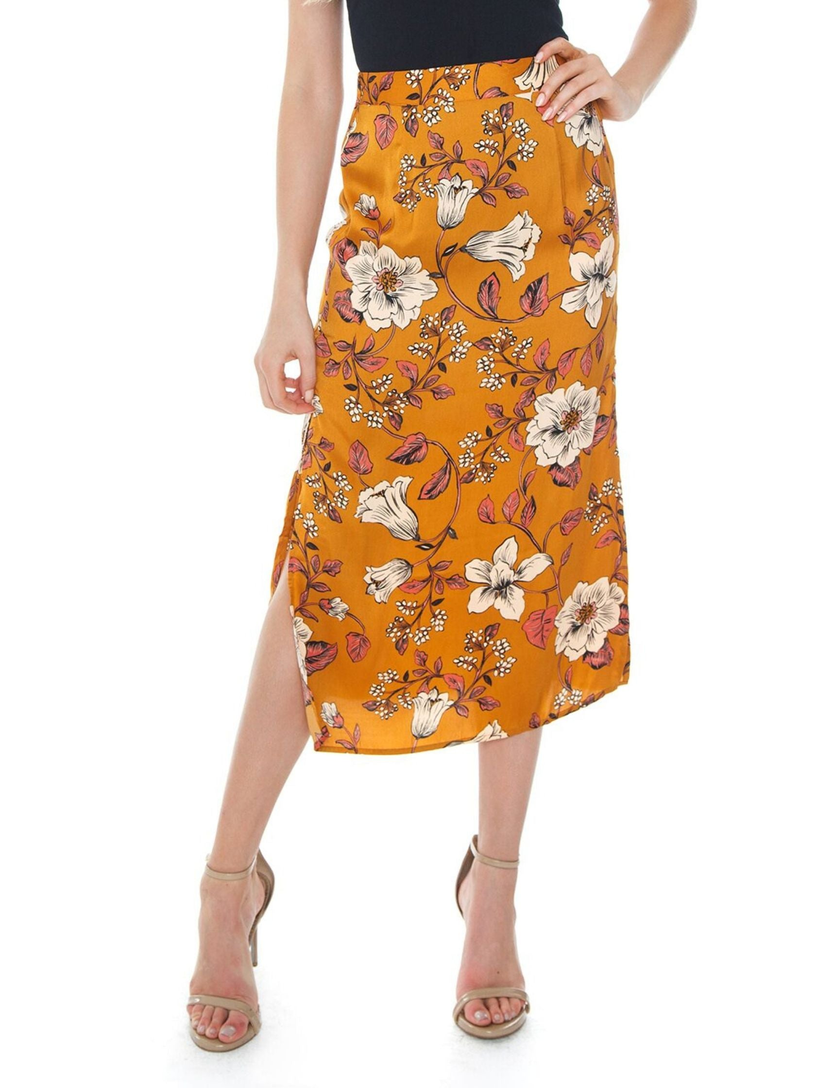 Woman wearing a skirt rental from SALTWATER LUXE called Gia Midi Skirt