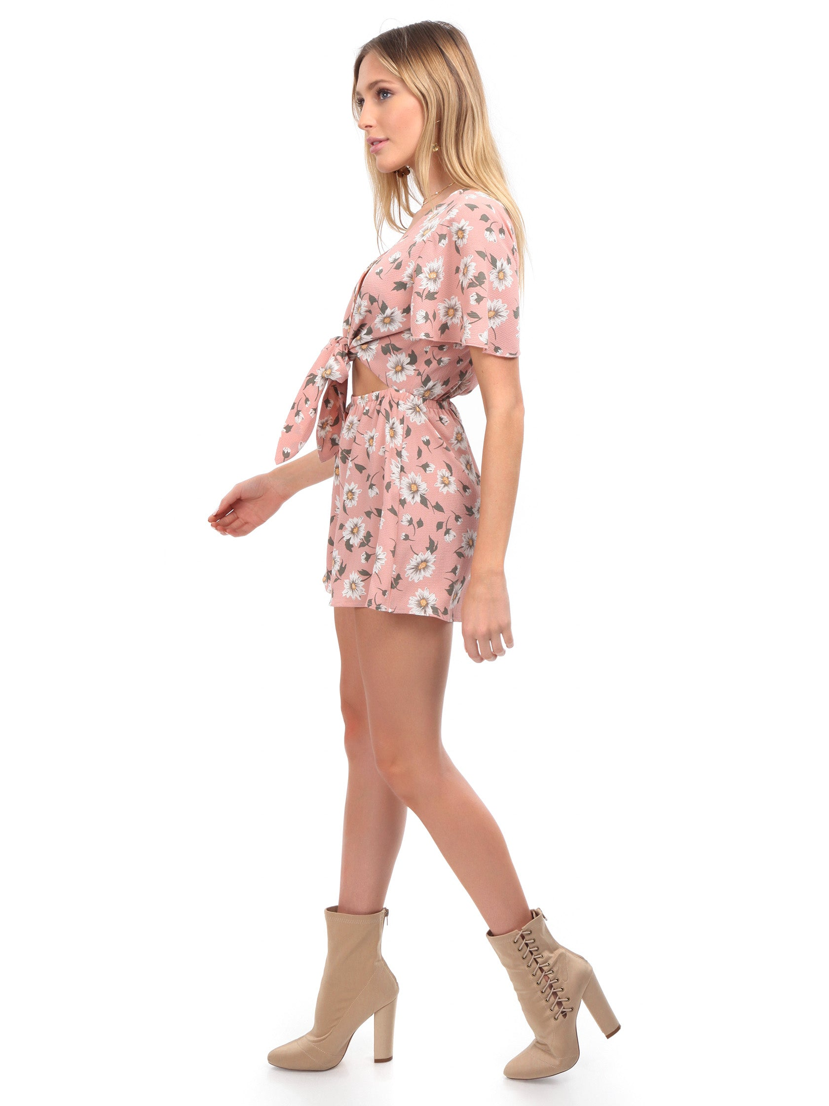 Woman wearing a romper rental from Show Me Your Mumu called Gia Romper