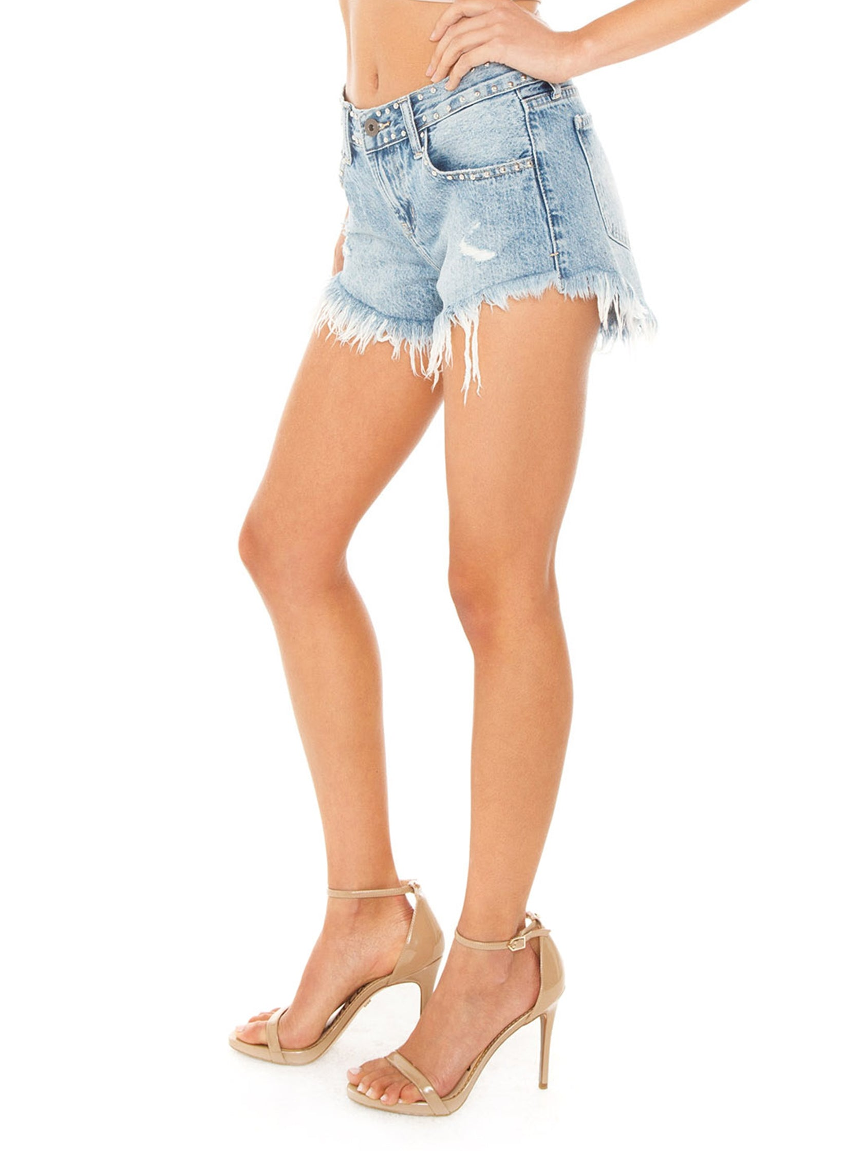 Women wearing a shorts rental from PISTOLA called Gigi Distressed Cutoff Denim Shorts