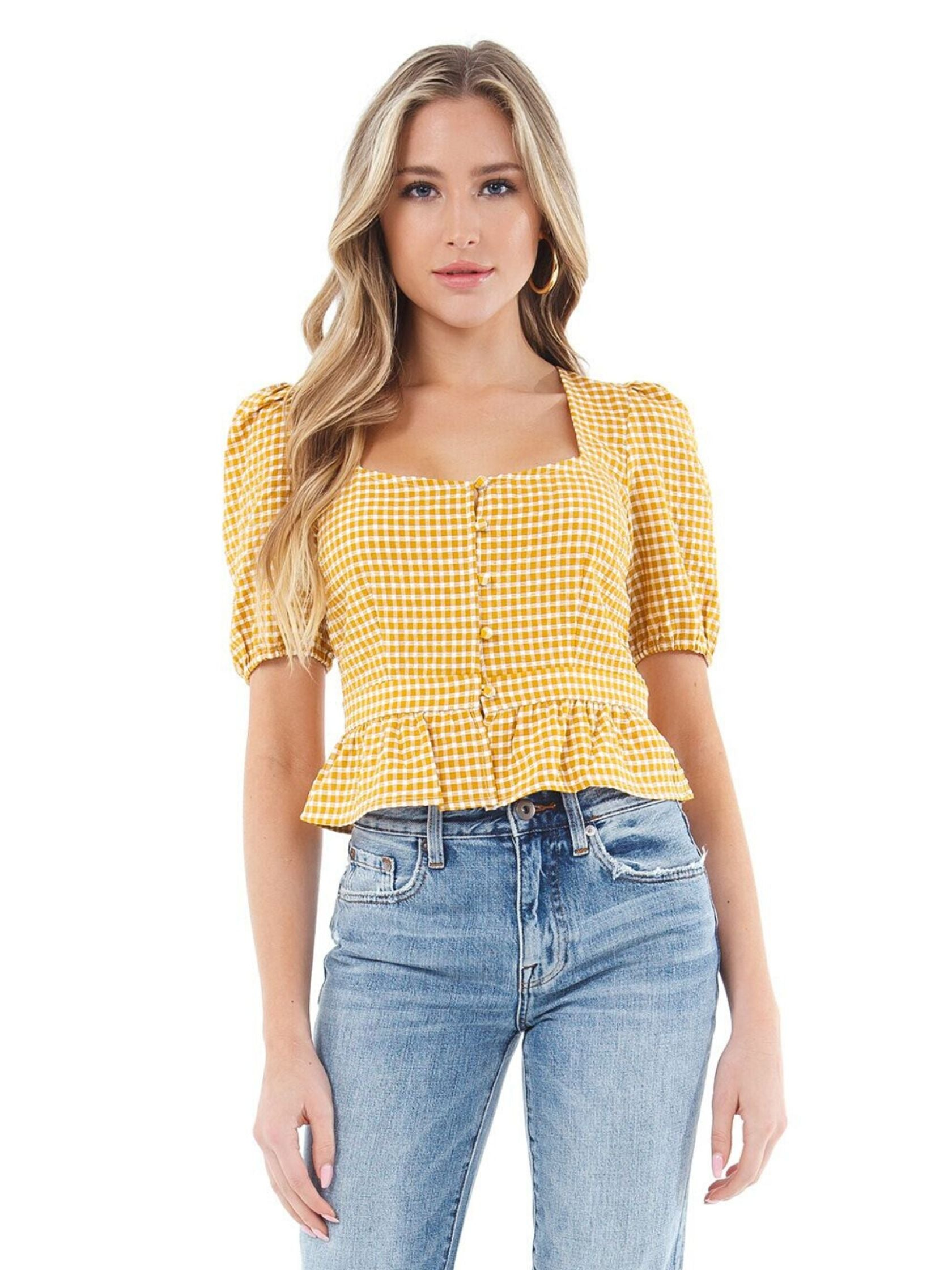 Woman wearing a top rental from BB Dakota called Gingham Seersucker Top