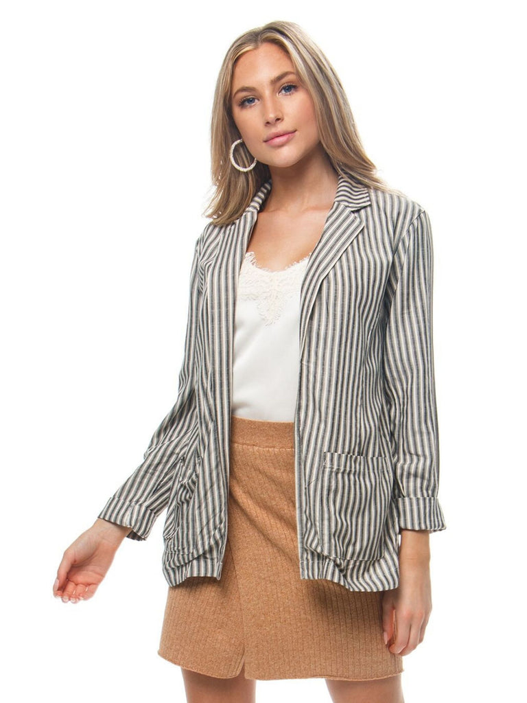 Woman wearing a blazer rental from BB Dakota called Gingham Seersucker Top