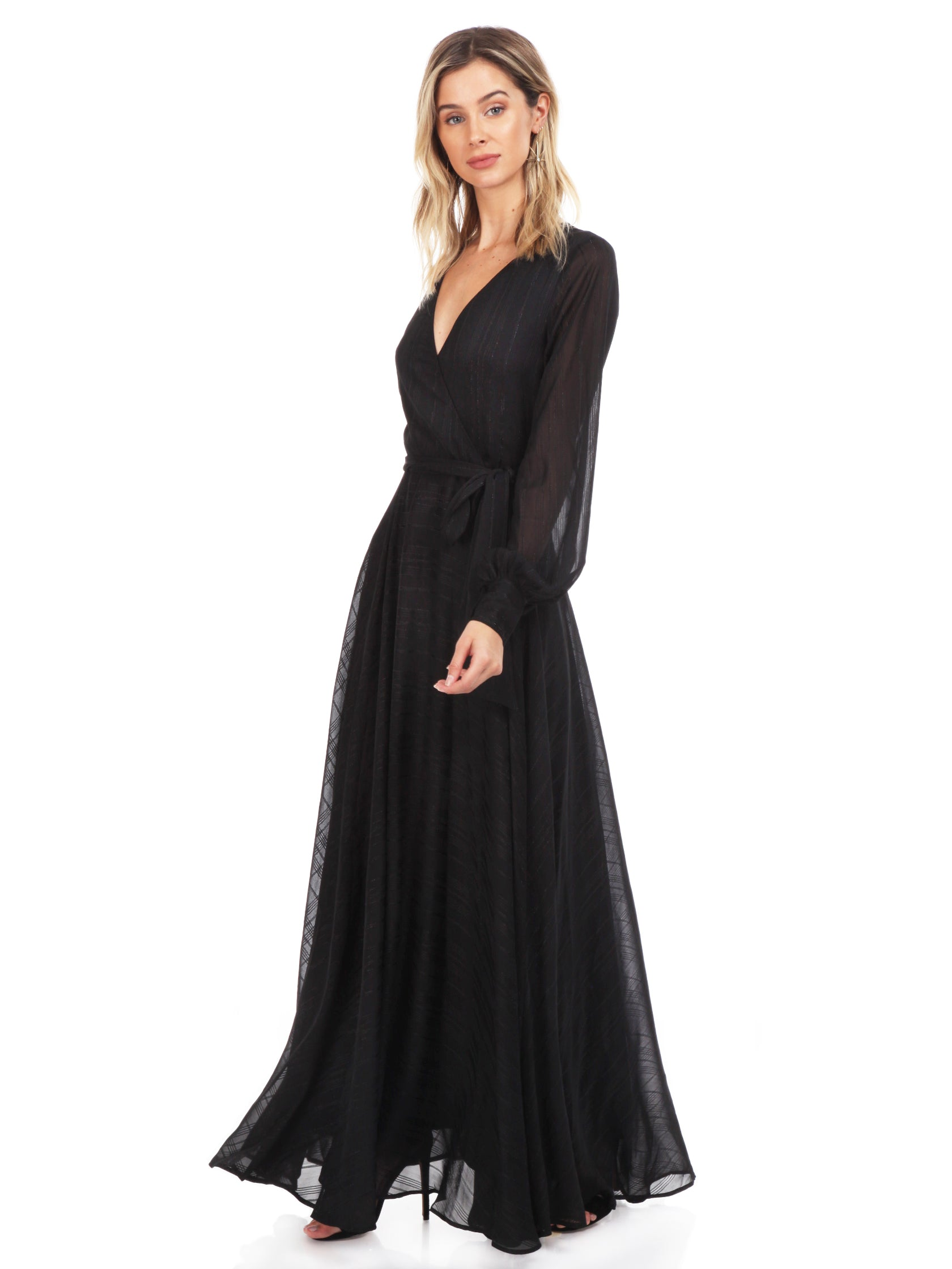 Woman wearing a dress rental from YUMI KIM called Giselle Maxi Dress