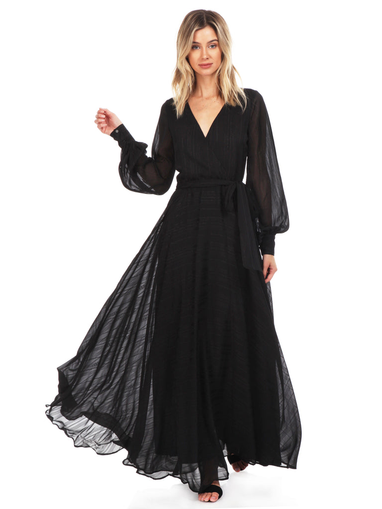 Girl wearing a dress rental from YUMI KIM called Meryl Long Sleeve Wrap Maxi Dress