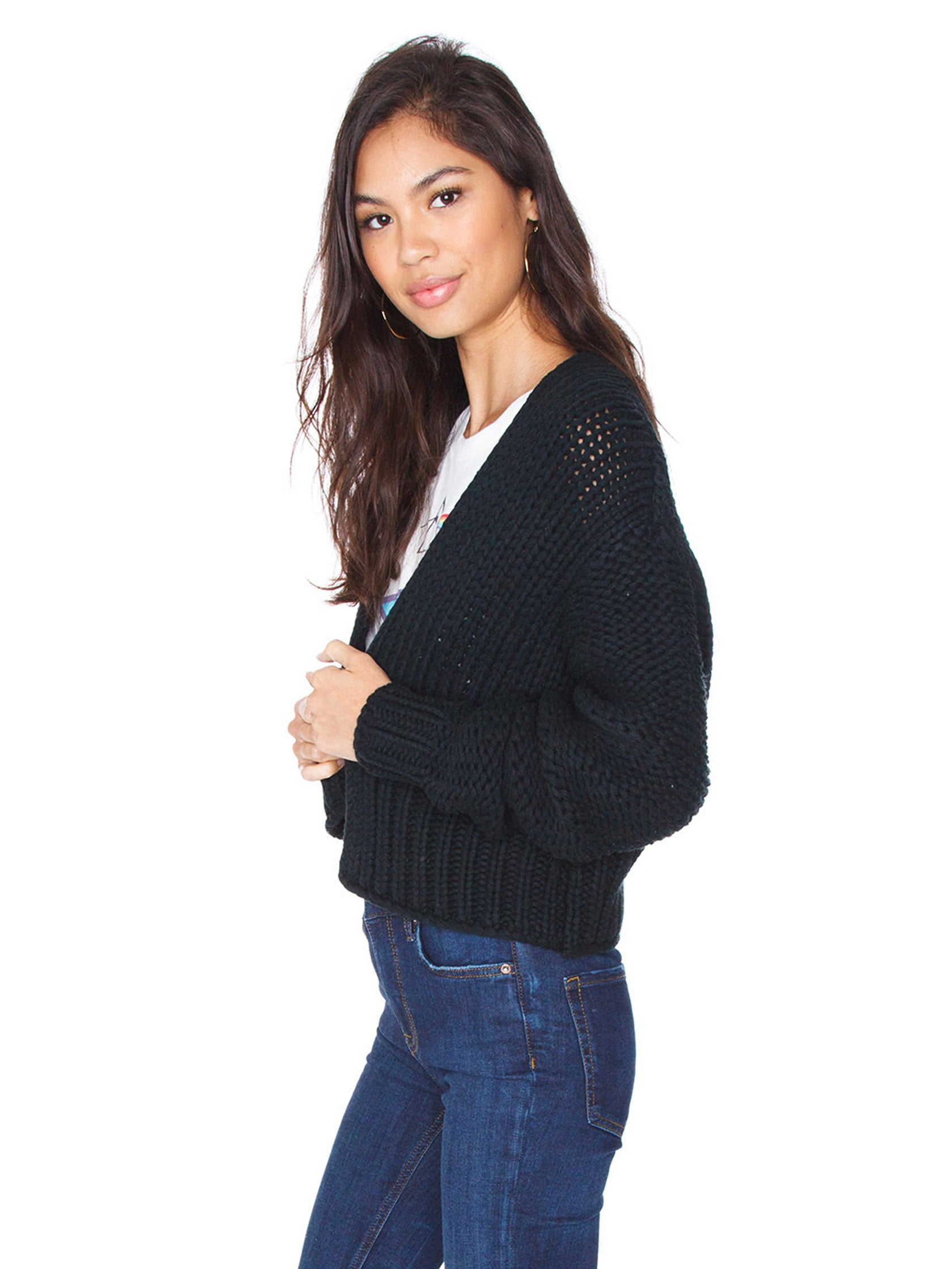 Women wearing a cardigan rental from Free People called Glow For It Cardi