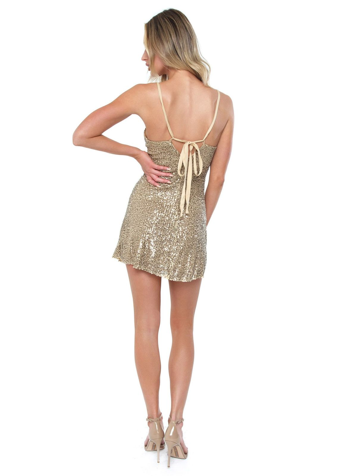 Women wearing a dress rental from Free People called Gold Rush Slip