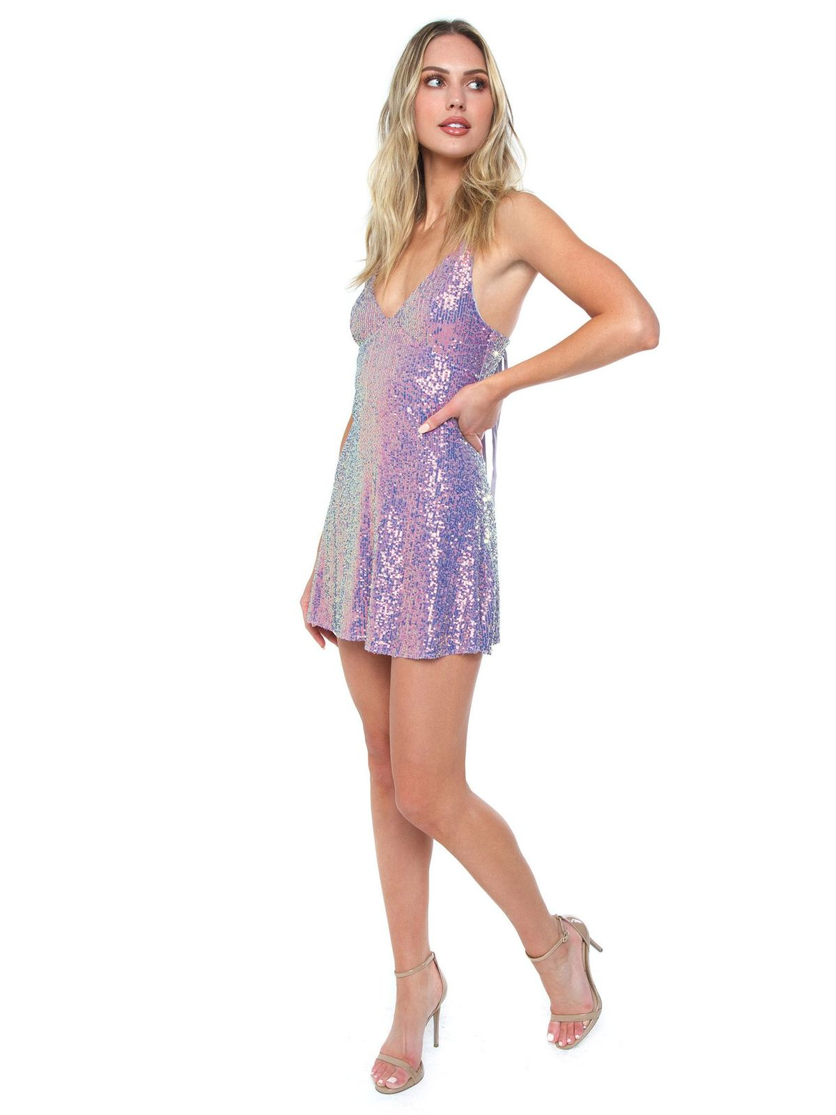 Woman wearing a dress rental from Free People called Gold Rush Slip