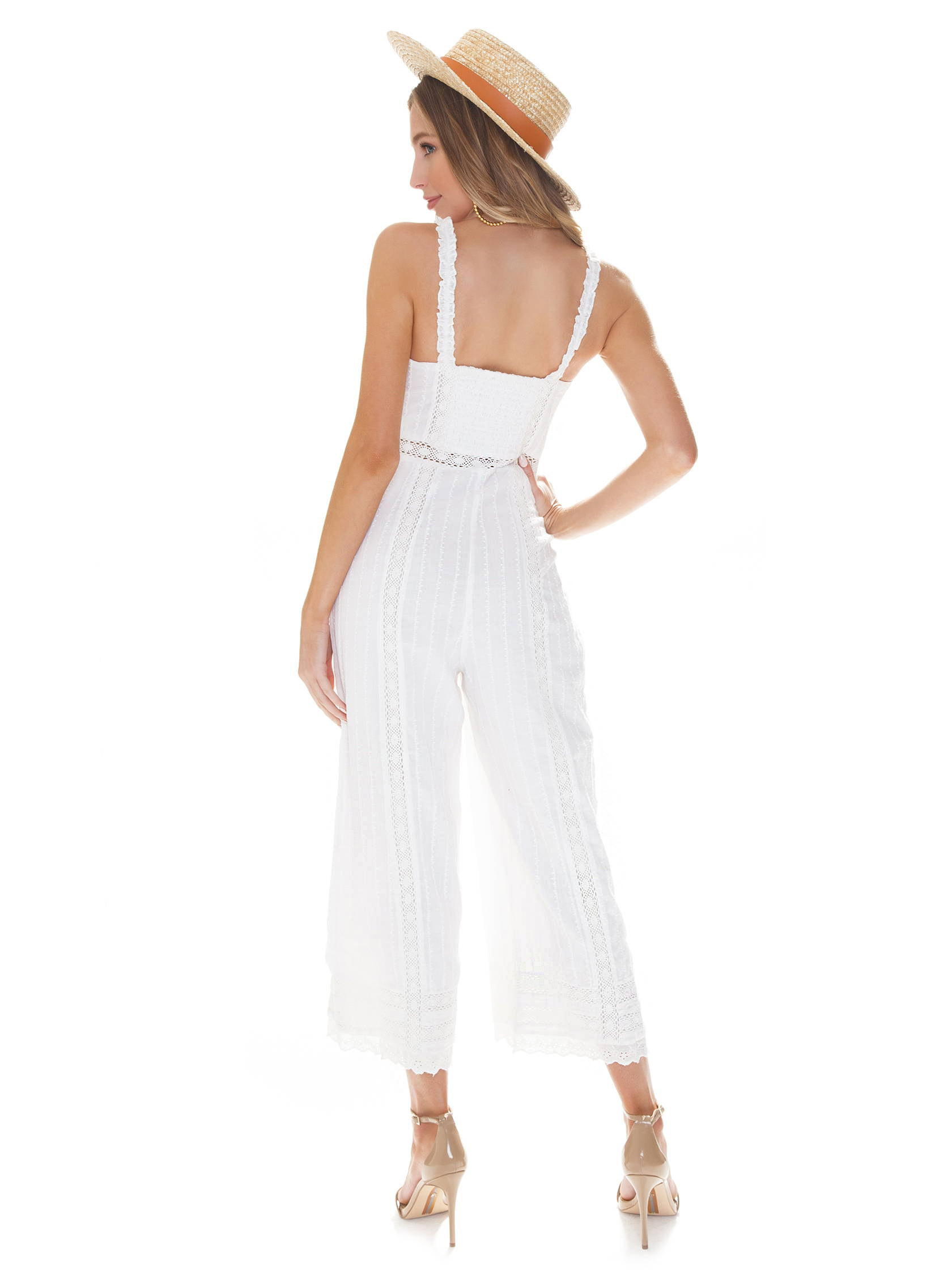 Women wearing a jumpsuit rental from Show Me Your Mumu called Greer Jumpsuit