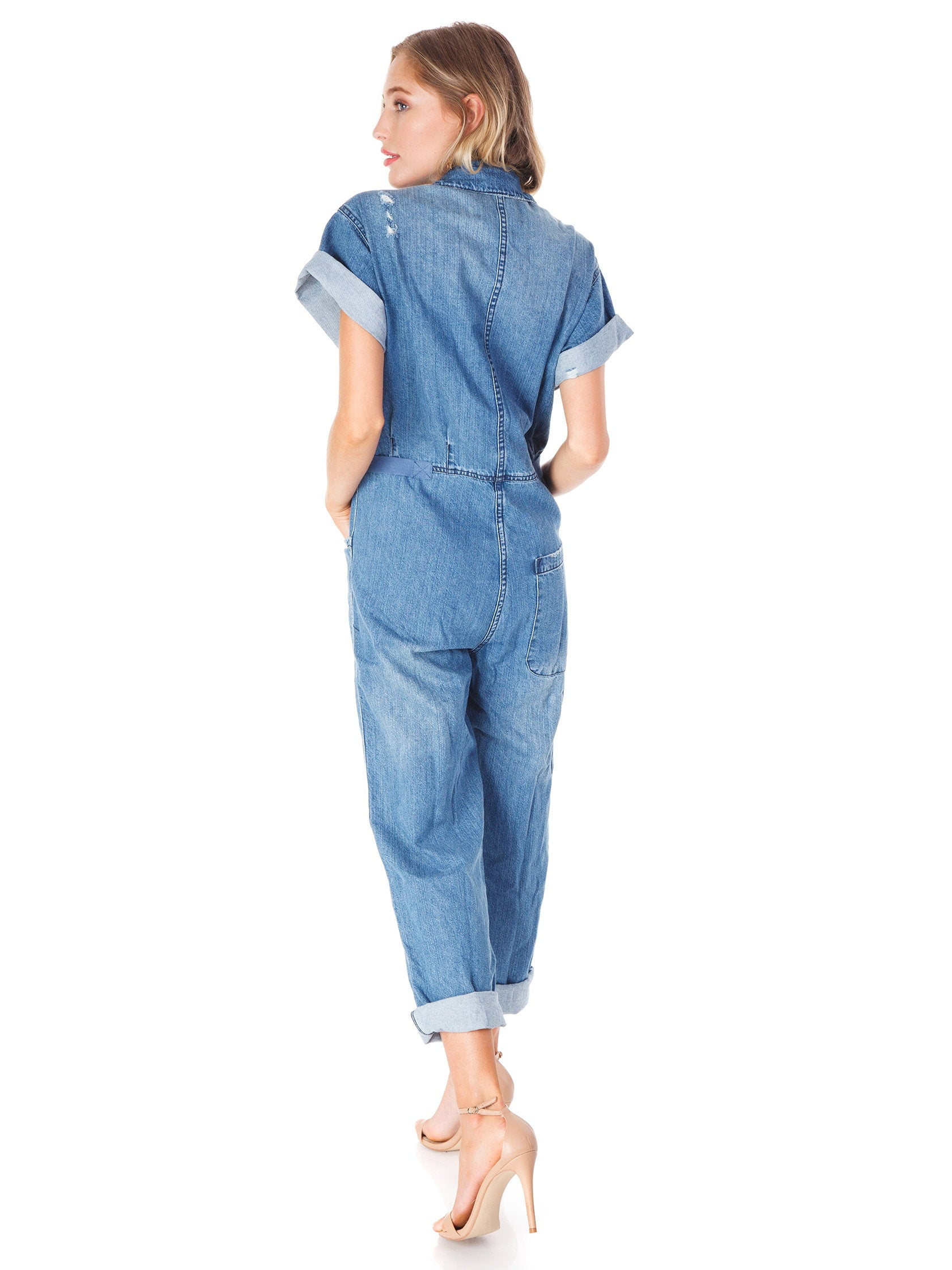 6b3a082be17 Women wearing a jumpsuit rental from PISTOLA called Grover Field Suit