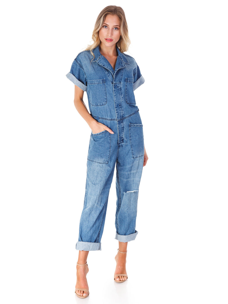 Women wearing a jumpsuit rental from PISTOLA called Eyelet Apron Jumpsuit
