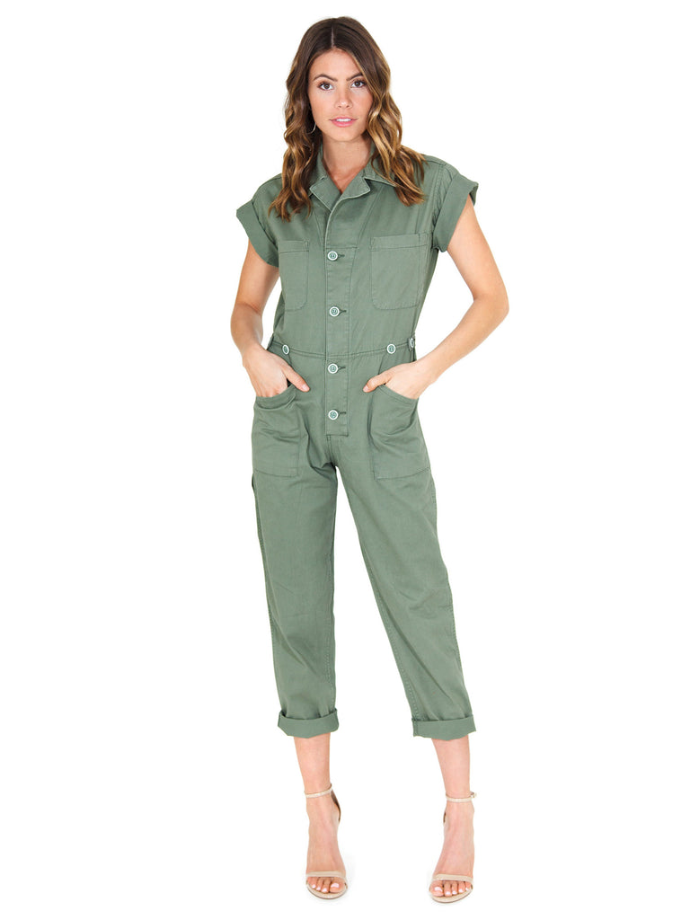 Women outfit in a jumpsuit rental from PISTOLA called Eyelet Apron Jumpsuit
