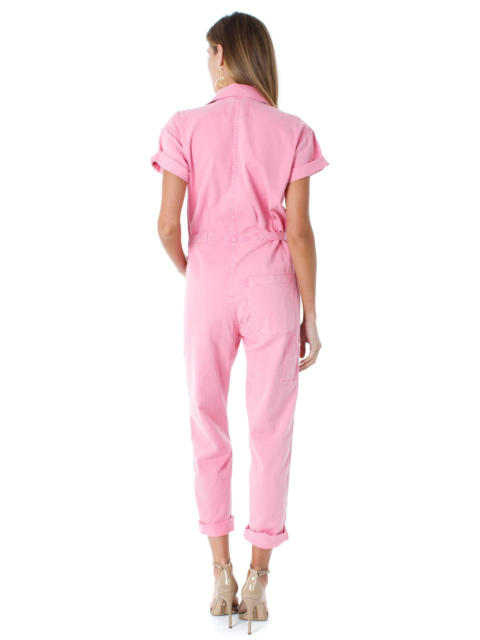 Women wearing a jumpsuit rental from PISTOLA called Grover Short Sleeve Field Suit