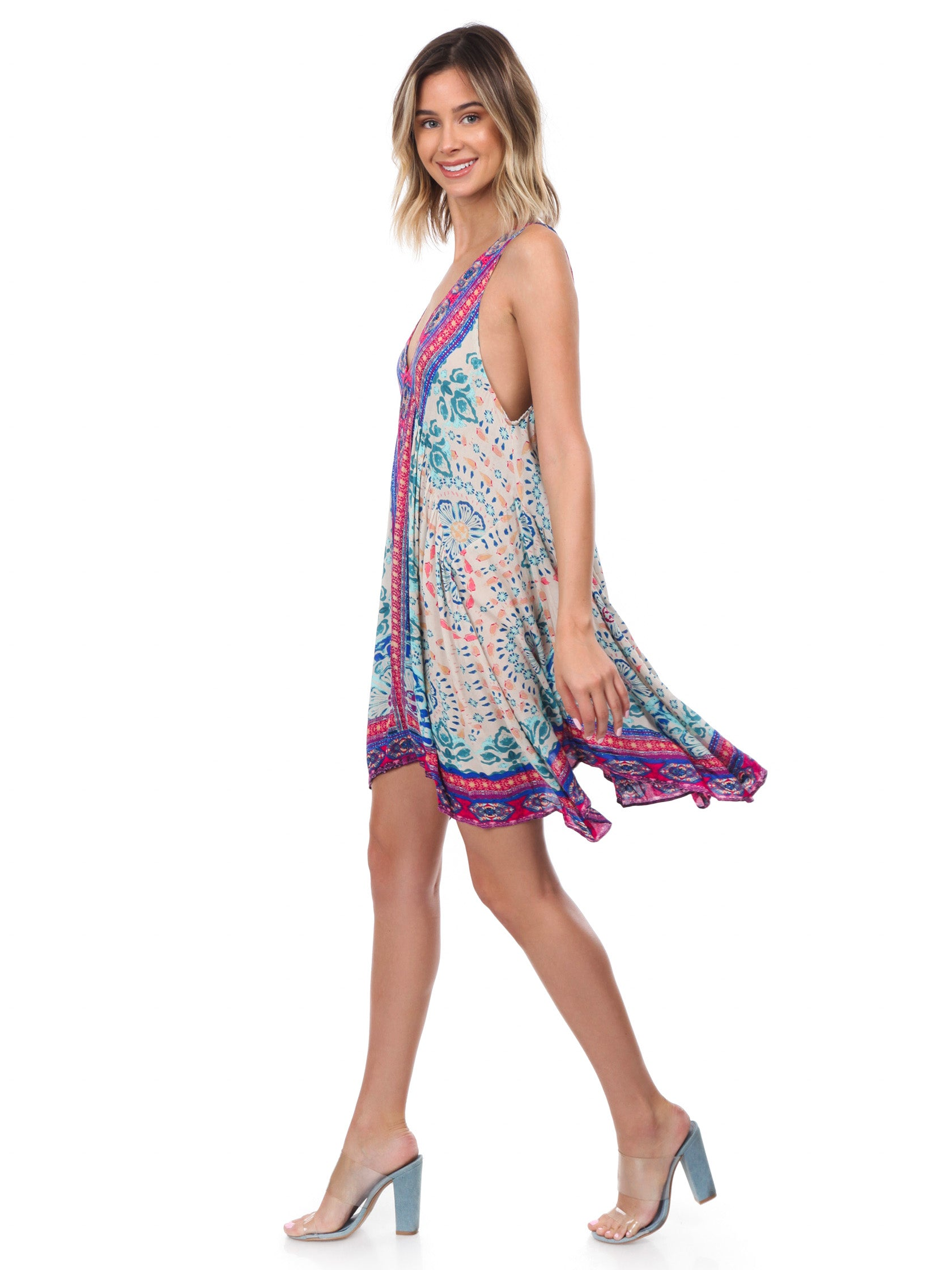 4444bb29454d1 Woman wearing a dress rental from Free People called Gypsy Trapeze Dress