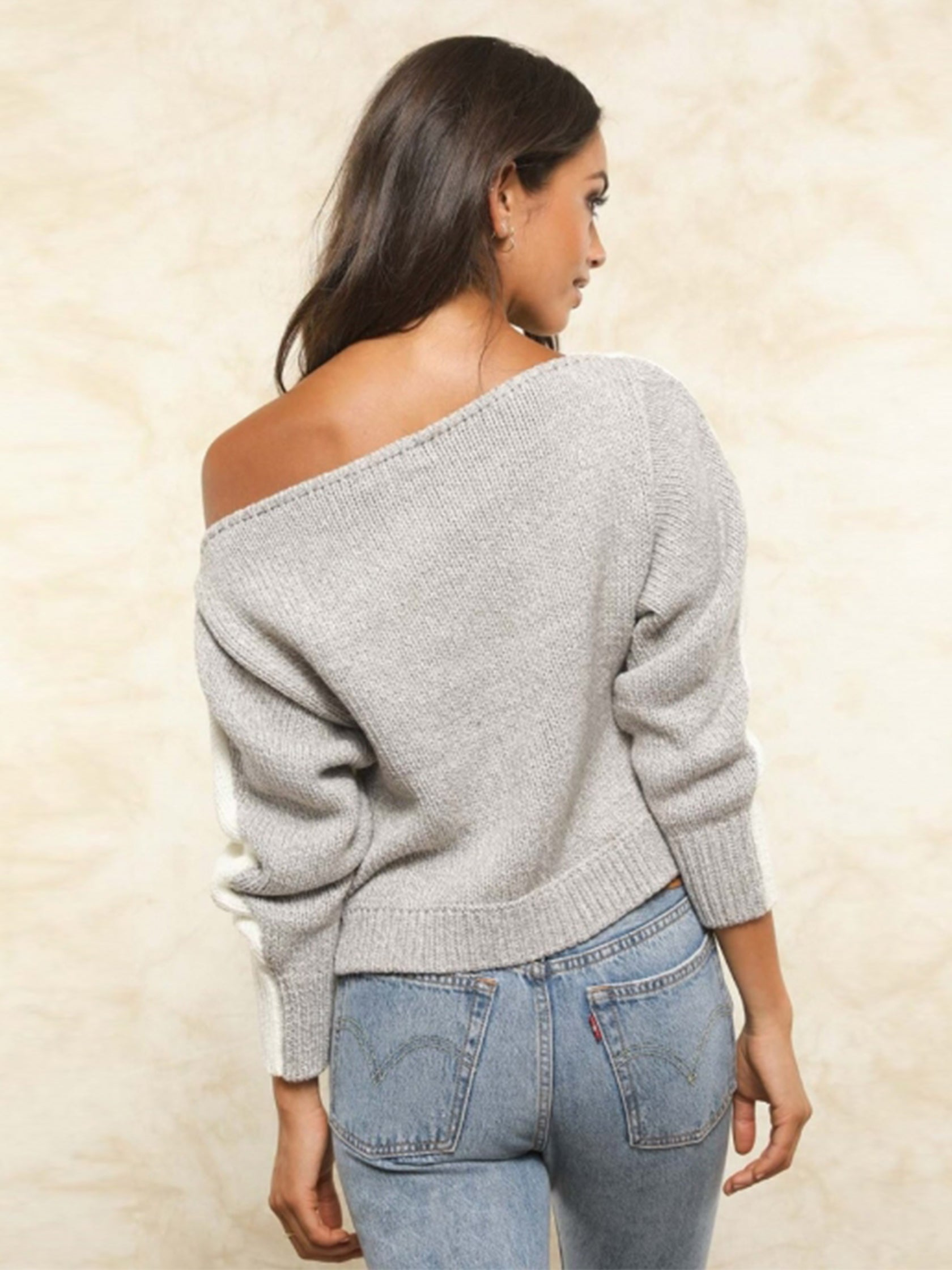 Girl wearing a sweater rental from FLETCH called Hannah Off Shoulder Reversible Sweater