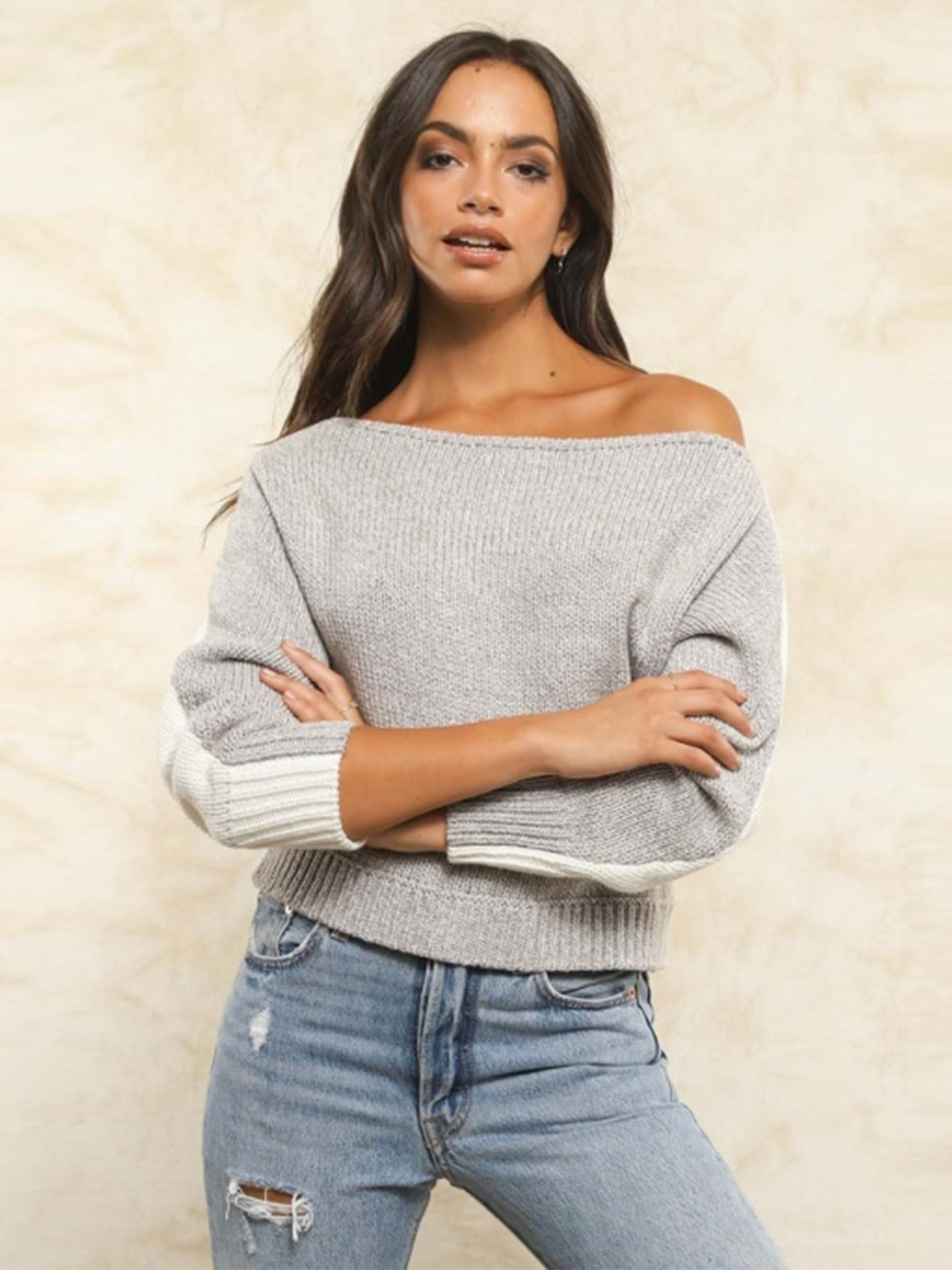 Women wearing a sweater rental from FLETCH called Hannah Off Shoulder Reversible Sweater