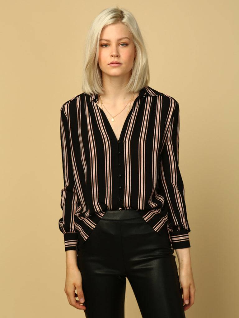 Women outfit in a top rental from Line & Dot called Ruffle Sleeve Striped Sweater